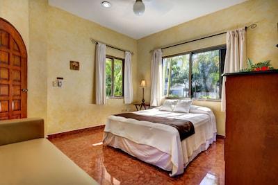 Queen size bed in first floor bedroom w/