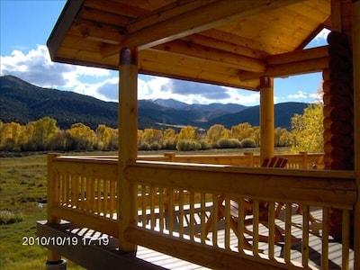 Gorgeous Mountain Views from Our Spacious Wrap Around Deck.