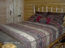 Two Private Bedrooms with Log Furniture and All Wood Interior.