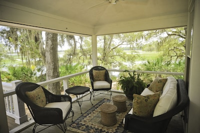 Our very comfortable porch with expansive marsh and water views!