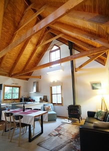 Huge cathedral ceilings give that real mountains cottage vibe.
