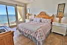 Master bedroom with a king size bed and view of the Gulf!