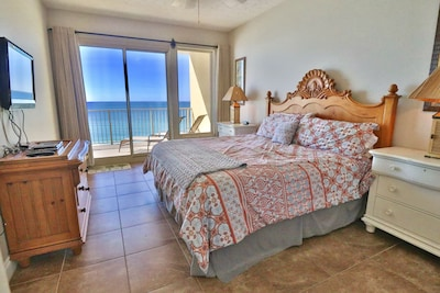 Sliding glass doors in the master bedroom give you access to the private balcony.