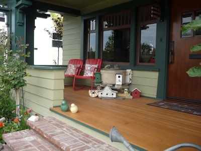 Large wooden front porch with fountain.