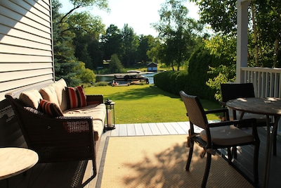 Lovely waterfront property on Lake Leelanau. Private setting on 1.6 acres