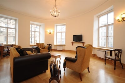 Sitting room is semi-circular and has four windows. Satellite TV