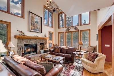 Living Room, window seat behind far sofa.