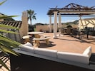 Our private top terrace: sun loungers, sofa, bbq, table & chairs, shade