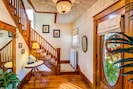 Stunning foyer with one of two stairways to the upper level.