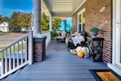 Relax on this large cozy front porch and watch the horse drawn carriages go by.