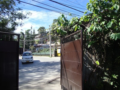 Access to property gate from M. Roxas Street. Road curve is wide and is lighted