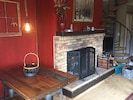 Eating area close to fire place and view of the mountains to the south and east