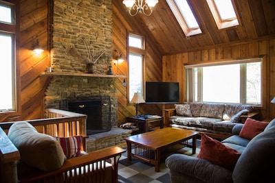 Natural Teak Floors, Stone Fireplace, and Fine Furnishings incl Flat Screen TV