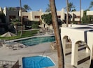 view from master bedroom balcony overlooking pool