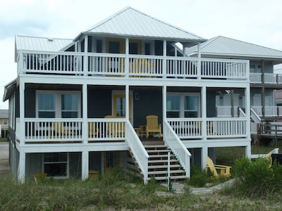 Photo shows lower left back patio accommodation. Patio view backyard and dunes