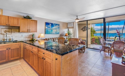 Newly remodeled kitchen with open counter looking out ocean view and living room