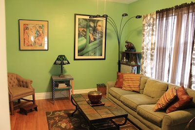 Shot of living room with queen sofa bed.