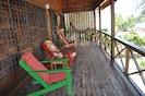 Beachfront Blue Moon Cabana. Large covered veranda with chairs and hammocks.