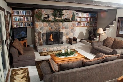 Main floor living room area with gas fireplace, library, Directv, DVD & WiFi.
