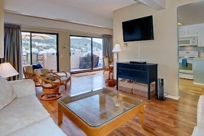 Living room with a 42' flat screen T.V. Also games and puzzles.