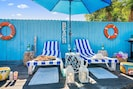 Enjoy your own tropical private backyard with a heated pool, sundeck and a BBQ. A perfect place for you to relax