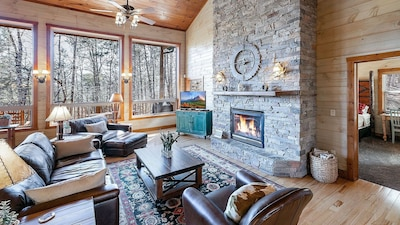 Stone gas fireplace in living room on main floor