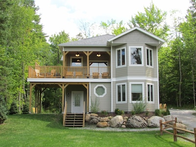 Upper deck hot tub with outstanding views of Whiteface and surrounding ranges.