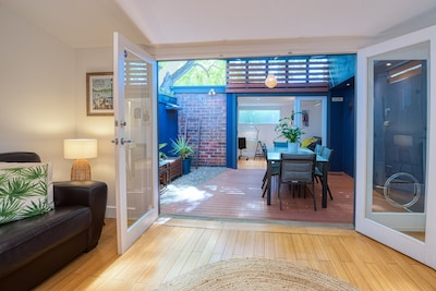 Light, bright and stylish. The cottage features an outdoor entertaining area.