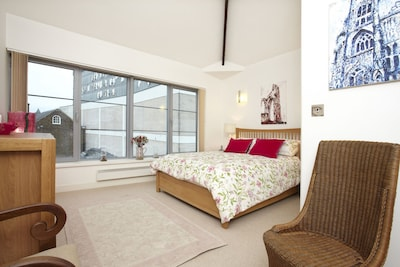 Master bedroom - spacious and light with rooftop views