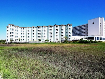 Back side of the condo bldg. Overlooking Singleton Swash/Marsh inlet.