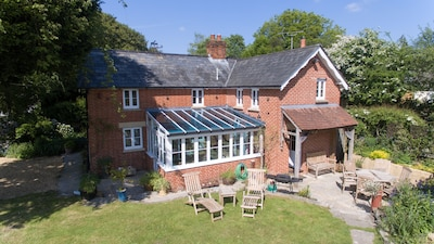 Detached  cottage with south facing garden and conservatory.