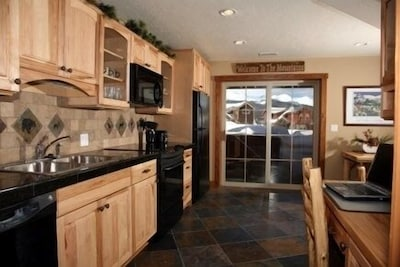 Beautiful, full modern  kitchen opens up onto the patio and hot tub area