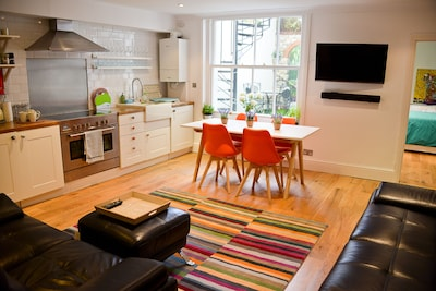 Beautiful living room with dining area and kitchen