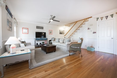 Spacious open Family Room with large screen smart TV and Alexa/Sonos smart speaker.