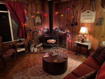 Cozy front room with wood burning stove.