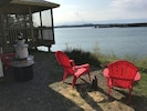 Small firepit overlooking ocean.  Adirondack chairs