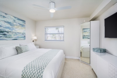 Beautiful Bedroom with a King Bed and Coastal, Original, Local Artwork