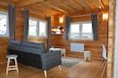 Salon cosy et chaleureux au confort tendance et moderne
