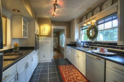 Gorgeous cottage kitchen with garden and bay views through dining room.