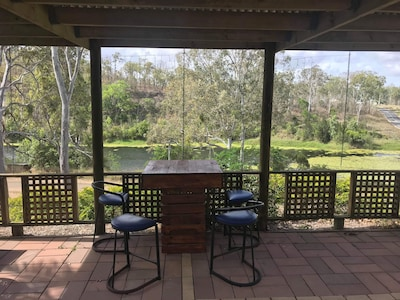 bar table overlooking the river
