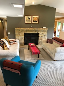 Wood burning fireplace with Queen size pull-out coach on left