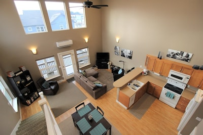 An overhead view of the living room, kitchen and dining area.