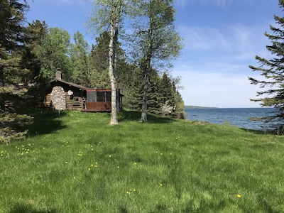 Side view of cabin with great lawn for croquet or games.