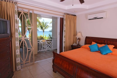 Master bedroom with patio access and sea view