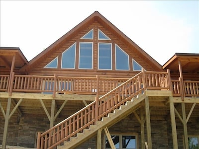 view of back of cabin with mountain views