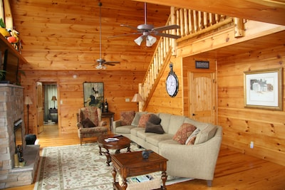 living room with fire place , TV,  DirecTV