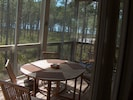 Enjoy a meal on the screened porch.