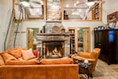Cozy living room with wood burning fireplace, seating for 4, flat screen TV.