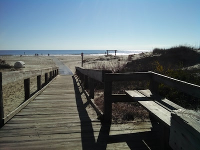 Just a short walk  out the gate, down the boardwalk, to the beautiful beach!