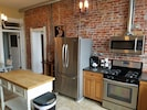 Gas stove top and small kitchen table to sip your coffee or tea! Cozy kitchen!